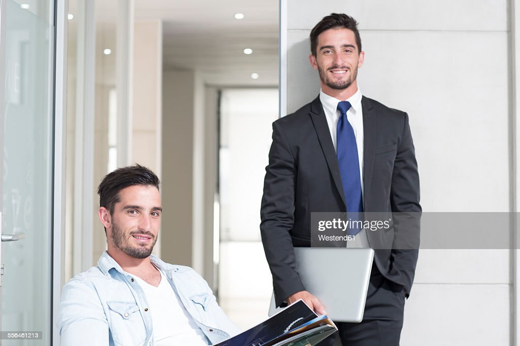 Casually And Formally Dressed Twin Males In Office Stock Photo