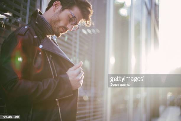 casually dressed businessman - biker jacket stock photos and pictures