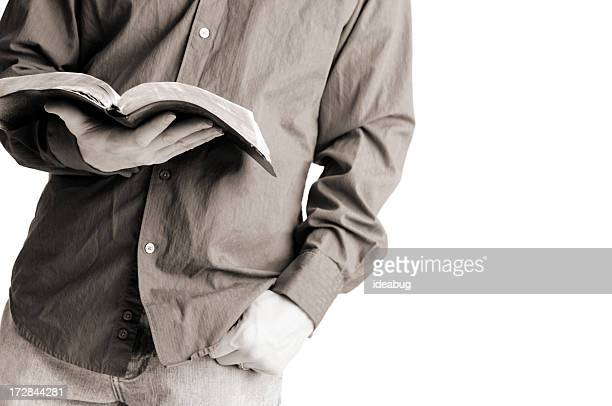 Casually Dressed Christian Man Holding Open Bible