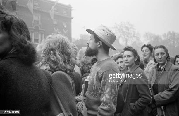 A casuallydressed spectator among the crowds in London during the wedding of Princess Elizabeth and Philip Mountbatten Duke of Edinburgh at...