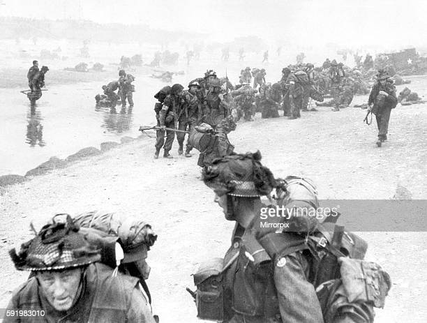 WW2 casualties from the initial assault on D Day are helped ashore on Sword Beach The 1st Battalion South Lancashire Regiment together with elements...