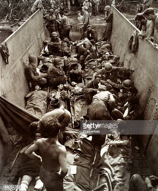 Casualties of World War Two lying on stretchers aboard a lighter near Guadalcanal, circa July 1943. This image is from the files of the United States...