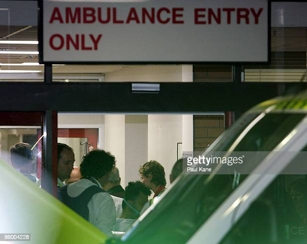 A casualty is wheeled on a stretcher from the ambulance into the emergency ward at Royal Perth hospital after a medical evacuation flight from Broome...