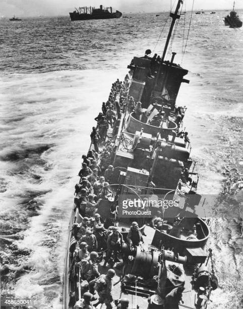 A casualty of the heavy Nazi fire against the DDay invasion fleet a Coast Guard LCI loaded with troops lists heavily to port before sinking in the...