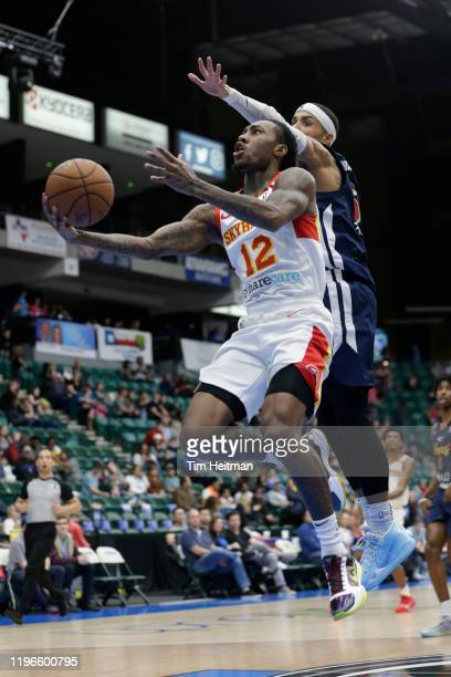 Cat Barber of the College Park Skyhawks drives against Jaylen Hoard of the Texas Legends during the second quarter on January 26, 2020 at Comerica...