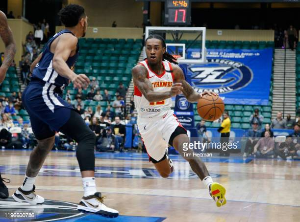 Cat Barber of the College Park Skyhawks drives against Josh Reaves of the Texas Legends during the first quarter on January 26, 2020 at Comerica...