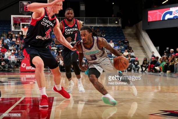 Cat Barber of the Greensboro Swarm drives around Thomas Welsh of the Capital City Go-Go during an NBA G-League game at the Entertainment and Sports...