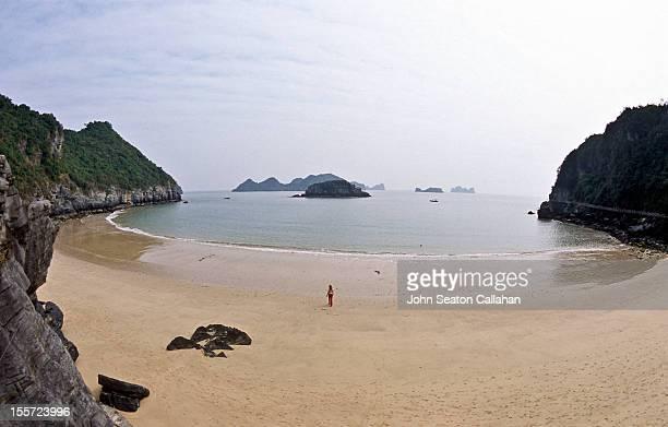 Cat Co beach, woman walking on sand