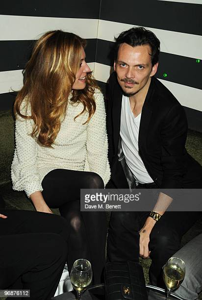 Cat Deeley and Matthew Williamson attend the Sass Bide party following their LFW catwalk show at Bungalow 8 on February 19 2010 in London England