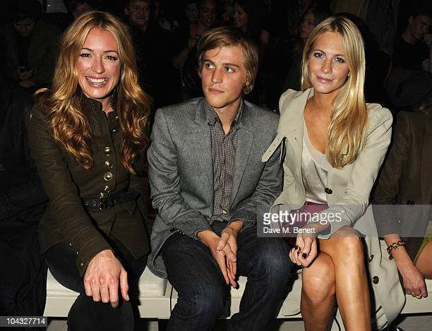 Cat Deeley and Poppy Delevingne attend the Burberry Prorsum Spring/Summer 2011 fashion show during LFW at Chelsea College of Art and Design on...