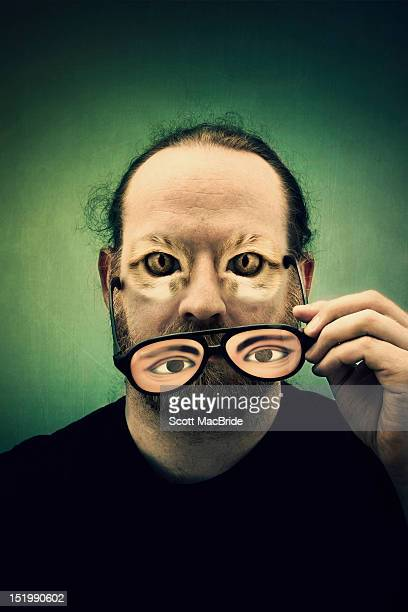 cat eyed man - scott macbride stock pictures, royalty-free photos & images