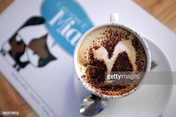 A cat is designed on an Italian cappuccino at the Miagola Cafe in Turin on March 22 2014 The newly opened Miagola Cafe is a concept bar where cats...