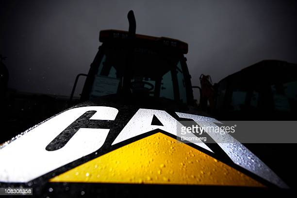 A 'Cat' logo of the Caterpillar Inc company is displayed on the front of a 'backhoe' digger at the factory in Desford UK on Tuesday Jan 25 2011...