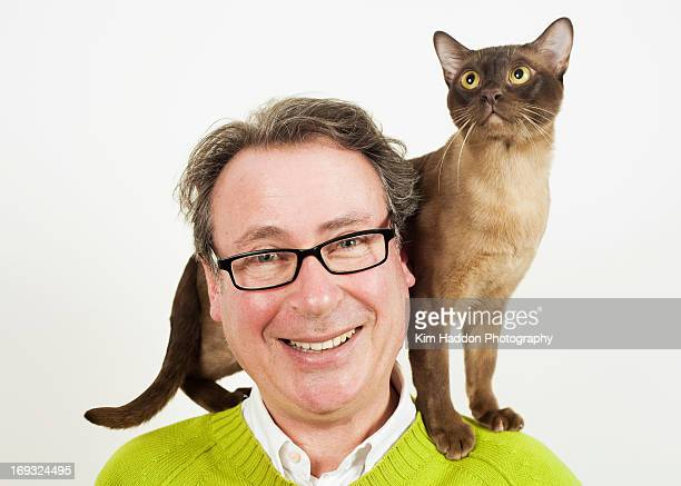 Cat on man's shoulders