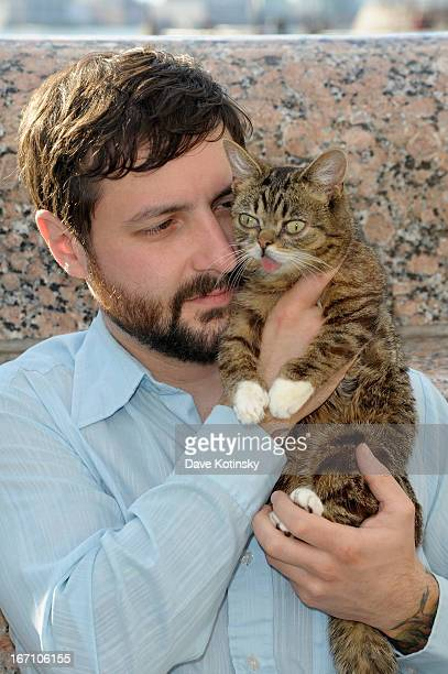 Cat owner Mike Bridavsky and celebrity internet cat Lil Bub attends the Lil Bub And Friendz Tribeca DriveIn Screening during the 2013 Tribeca Film...