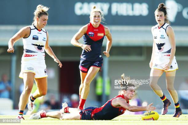 Cat Phillips of the Demons paddles the ball forward during the round two AFLW match between the Melbourne Demons and the Adelaide Crows at Casey...
