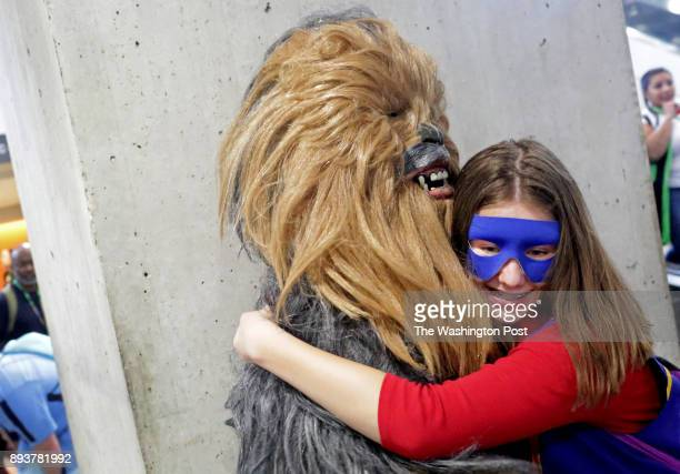 Cat Ramage dressed as Ms Marvel hugs her dad David Ramage dressed as Chewbacca at Comic Con at the Javits Center in Manhattan NY on October 06 2017