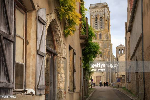 cat sleeping on sill  in french village - abby road stock photos and pictures