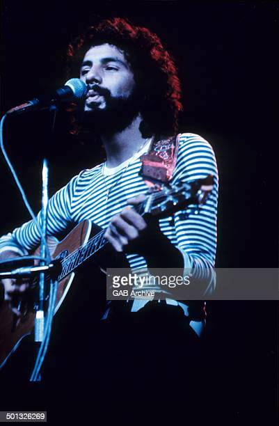 Cat Stevens performs on stage circa 1975
