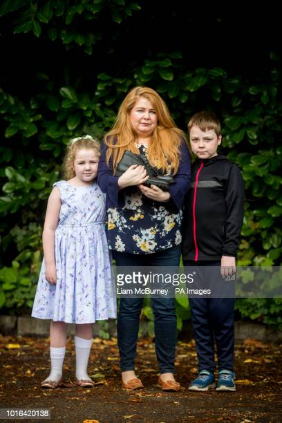 Cat Wilkinson daughter of Michael Gallagher with her daughter Fara aged 8 and son Fynn aged 10 outside the offices of Omagh Support amp Self Help...