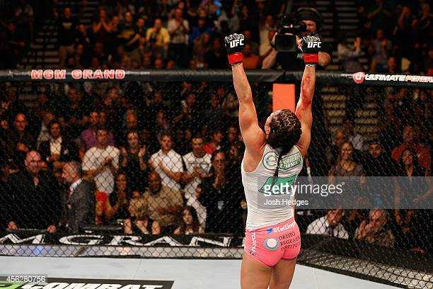 Cat Zingano celebrates after her TKO win over Amanda Nunes in their women's bantamweight fight during the UFC 178 event inside the MGM Grand Garden...
