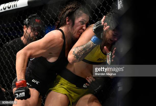 Cat Zingano clinches with Ketlen Vieira of Brazil against the cage in their women's bantamweight bout during the UFC 222 event inside TMobile Arena...