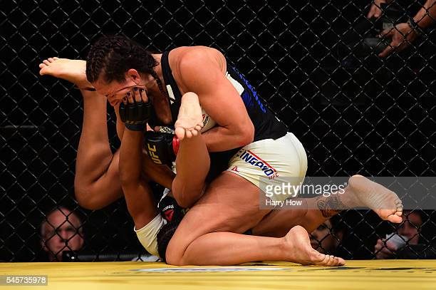 Cat Zingano grapples with Julianna Pena in their women's bantamweight bout during the UFC 200 event on July 9 2016 at TMobile Arena in Las Vegas...