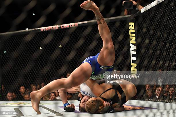 Cat Zingano grapples with Ronda Rousey in their UFC women's bantamweight championship bout during the UFC 184 event at Staples Center on February 28...