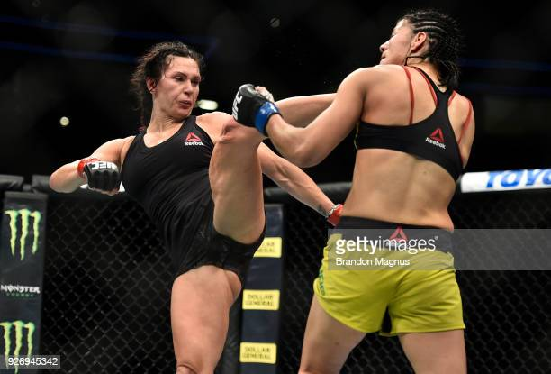 Cat Zingano kicks Ketlen Vieira of Brazil in their women's bantamweight bout during the UFC 222 event inside TMobile Arena on March 3 2018 in Las...