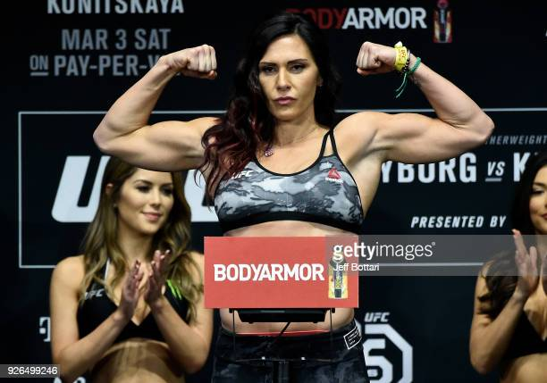Cat Zingano poses on the scale during a UFC 222 weighin on March 2 2018 in Las Vegas Nevada
