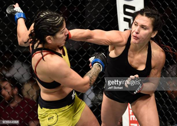 Cat Zingano punches Ketlen Vieira of Brazil in their women's bantamweight bout during the UFC 222 event inside TMobile Arena on March 3 2018 in Las...