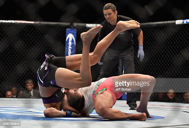 Cat Zingano takes down Amanda Nunes in their women's bantamweight fight during the UFC 178 event inside the MGM Grand Garden Arena on September 27...