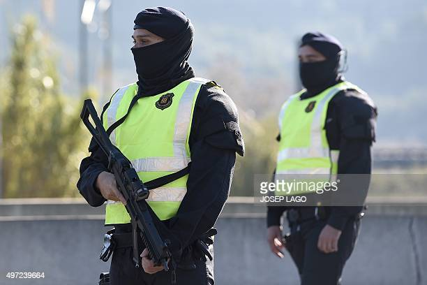 Catalan Autonomous Police officers known as Mosso d'Esquadra stand guard at a toll station during vehicles controls on a motorway of Barcelona...