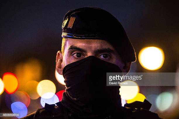 Catalan Autonomous riot police officer stands guard at the first Pegida rally on March 11 2015 in Barcelona Spain Pegida Catalonia has called for the...