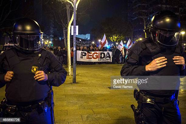 Catalan Autonomous riot police officers escort members of Pegida Spain at the end of the first Pegida rally on March 11, 2015 in Barcelona, Spain....