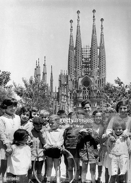 Catalan Children Posing Before The Sagrada Familia Designed By Gaudi In Barcelona Around 1934