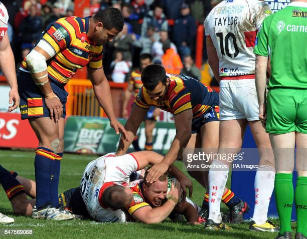 Catalan Dragons' Ian Henderson is congratulated after going over to score his side's third try during the Carnegie Challenge Cup match at the MS3...