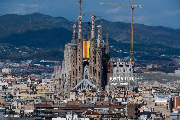 Catalan flag hangs on La Sagrada Familia during the Catalan National Day on September 11 2017 in Barcelona Spain The Spanish Northeastern autonomous...