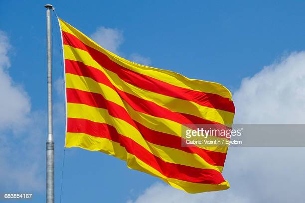 Catalan Flag Waving Against Sky