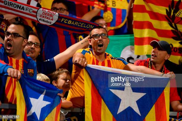 Catalan football fans hold Esteladas before the Spanish league football match Girona FC vs FC Barcelona at the Montilivi stadium in Girona on...