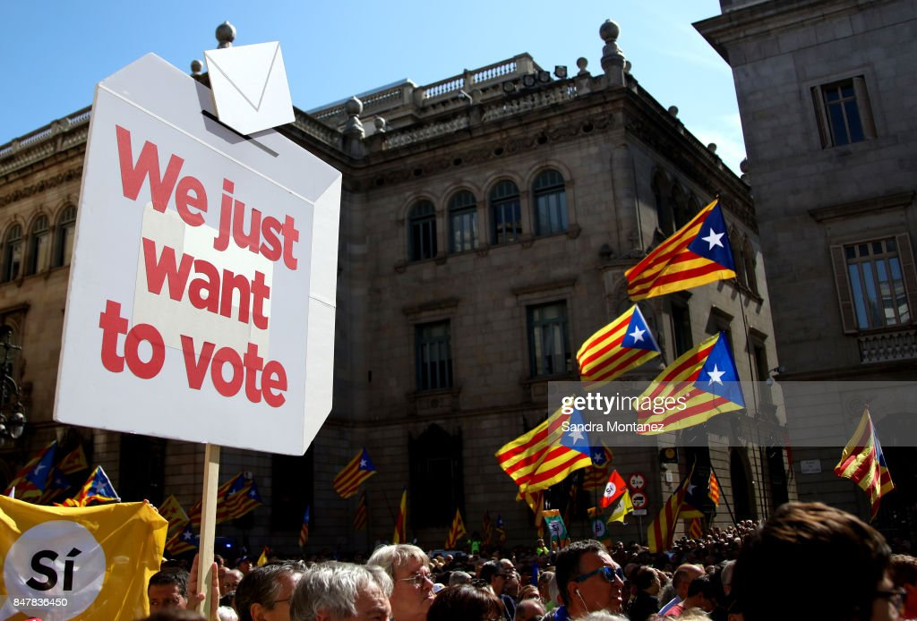 Catalan Independence referendum supporters hold a sign up saying 'We just want to vote' during a demonstration of Catalan Mayors backing Independence Referendum on September 16, 2017 in Barcelona, Spain. 712 Catalan mayors who have backed the independence referendum were summoned by Spain's State Prosecutor over the independence vote, threatening arrests over non-cooperation. The vote on breaking away from Spain was called by the Catalan government for October 1, 2017 but was suspended by the Spanish Constitutional Court following a demand from the Spanish Government. Catalan and Spanish security forces have been instructed by Spain's Public Prosecutor's Office to take all the elements which could promote or help to celebrate the referendum. This includes ballots, ballots boxes and promotional material.