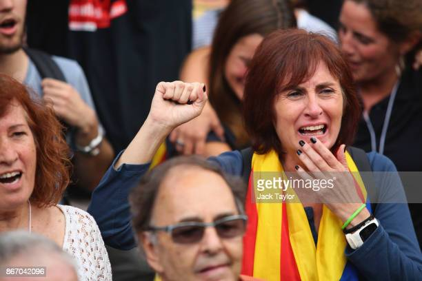 Catalan independence supporter reacts to the news that the Catalan Parliament votes to declare independence from Spain outside the Parliament of...