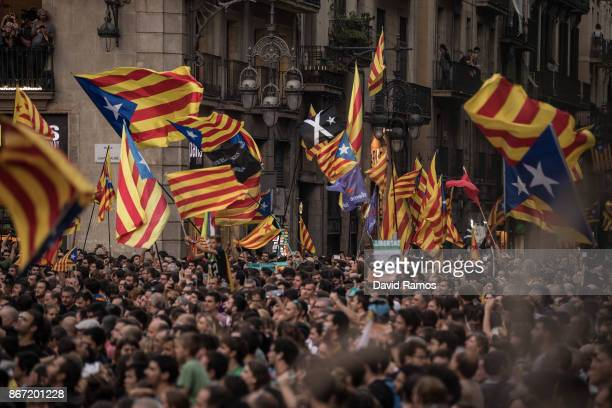 Catalan Independence supporters gather outside the Catalan Government building Palau de la Generalitat to celebrate their vote on independence from...