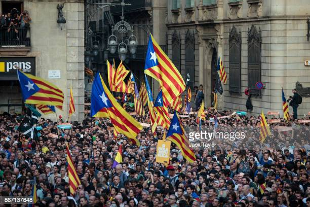 Catalan independence supporters hold a rally in front of the Generalitat de Catalunya after the Catalan Parliament voted to declare independence from...