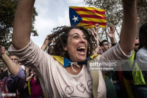 Catalan independence supporters massed outside the Parliament of Catalonia react with joy at the news that the Catalan Parliament votes to declare...