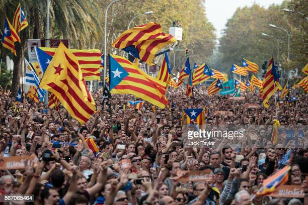 Catalan independence supporters react to the news that the Catalan Parliament votes to declare independence from Spain outside the Parliament of...