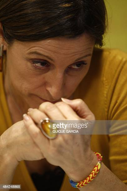 Catalan linguist and Catalan National Assembly president Carme Forcadell gestures during an interview with AFP in Barcelona on April 9, 2014. The...