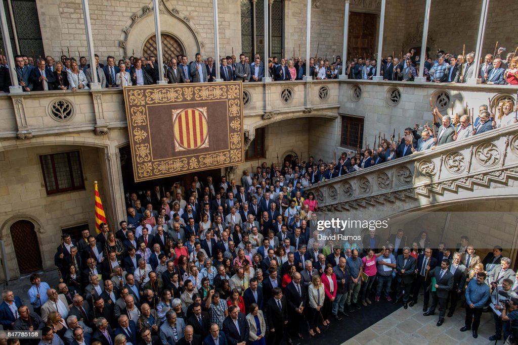 Catalan Mayors backing Independence Referendum gather inside the Palau de La Generalitat, building of the Catalan government, during a demonstration on September 16, 2017 in Barcelona, Spain. 712 Catalan mayors who have backed the independence referendum were summoned by Spain's State Prosecutor over the independence vote, threatening arrests over non-cooperation. The vote on breaking away from Spain was called by the Catalan government for October 1, 2017 but was suspended by the Spanish Constitutional Court following a demand from the Spanish Government. Catalan and Spanish security forces have been instructed by Spain's Public Prosecutor's Office to take all the elements which could promote or help to celebrate the referendum. This includes ballots, ballots boxes and promotional material.
