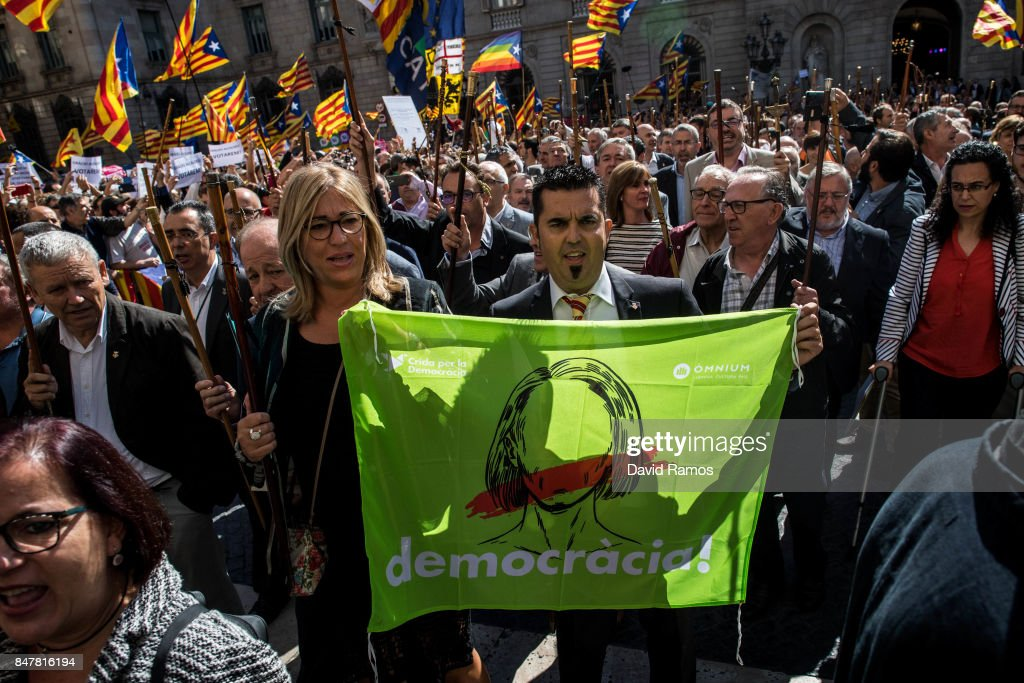 Catalan mayors make their way towards the Generalitat de Catalunya, building of the Catalan government, during a demonstration on September 16, 2017 in Barcelona, Spain. 712 Catalan mayors who have backed the independence referendum were summoned by Spain's State Prosecutor over the independence vote, threatening arrests over non-cooperation. The vote on breaking away from Spain was called by the Catalan government for October 1, 2017 but was suspended by the Spanish Constitutional Court following a demand from the Spanish Government. Catalan and Spanish security forces have been instructed by Spain's Public Prosecutor's Office to take all the elements which could promote or help to celebrate the referendum. This includes ballots, ballots boxes and promotional material.