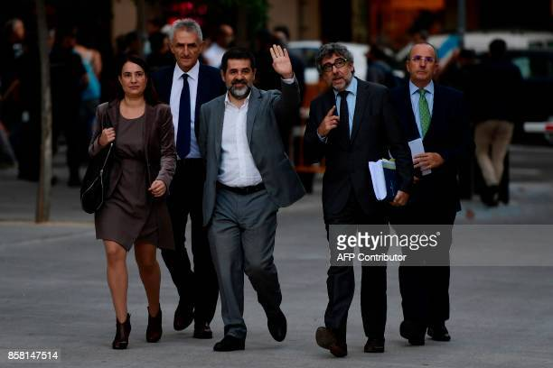 Catalan National Assembly president Jordi Sanchez who is under investigation for sedition waves as he arrives to the High Court in Madrid on October...